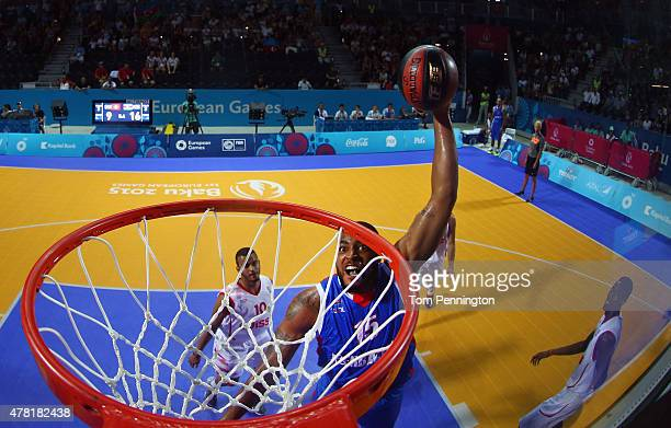 Marshall Obrain Moses of Azerbaijan drives to the basket against Mathias Tolusso during the Men's 3x3 Basketball Pool D match on day eleven of the...