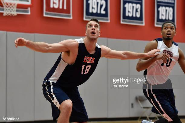 Marshall Plumlee and Will Davis II of the USA AmeriCup Team wait for a rebound during a training camp at the University of Houston in Houston Texas...