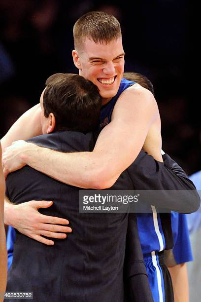 Marshall Plumlee congratulates head coach Mike Krzyzewski of the Duke Blue Devils on his 1000th during a college basketball game against the St...