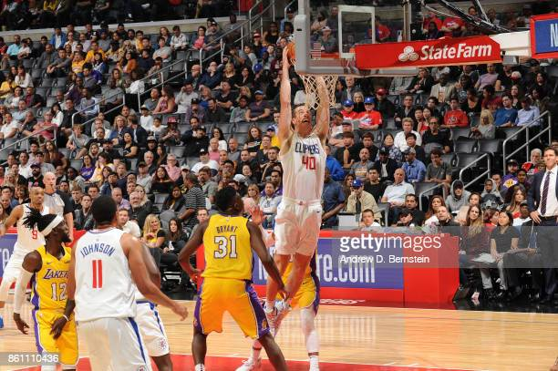 Marshall Plumlee of the LA Clippers goes up for a dunk against the Los Angeles Lakers on October 13 2017 at STAPLES Center in Los Angeles California...
