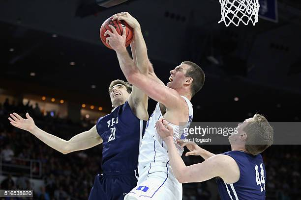 Marshall Plumlee of the Duke Blue Devils battles for the ball with Nick Victor of the Yale Bulldogs and Sam Downey in the second half of their game...