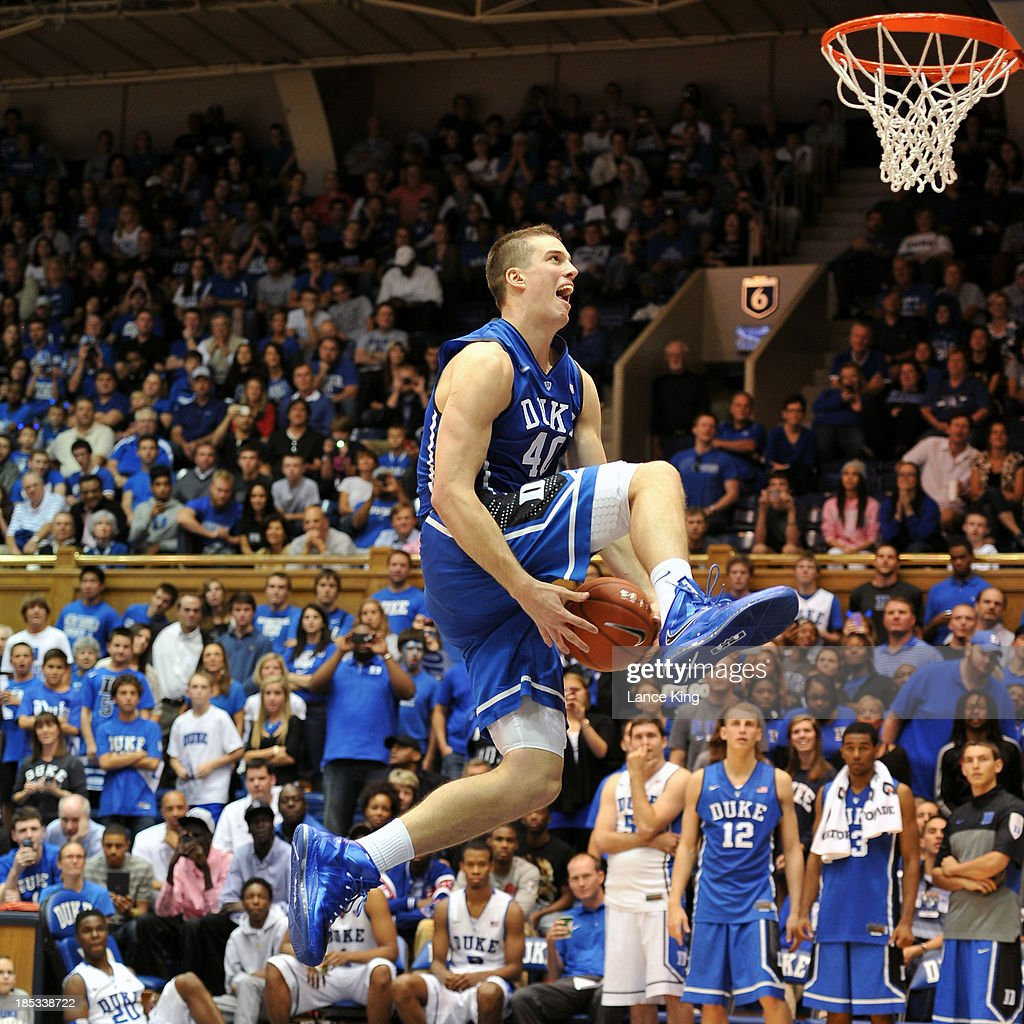 Marshall Plumlee #40 of the Duke Blue Devils competes in a dunk contest during Countdown to Craziness at Cameron Indoor Stadium on October 18, 2013 in Durham, North Carolina.