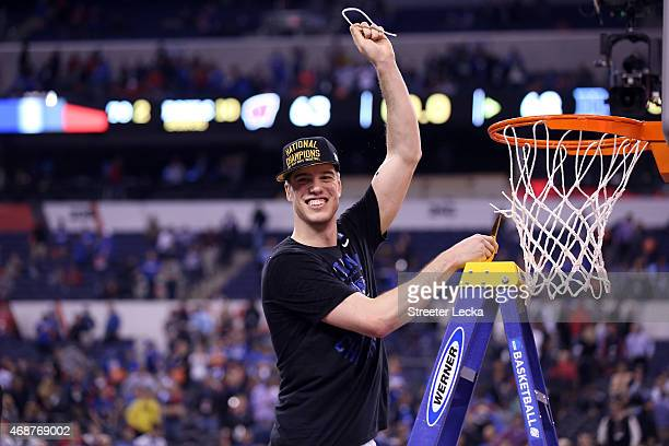 Marshall Plumlee of the Duke Blue Devils cuts down the net after defeating the Wisconsin Badgers during the NCAA Men's Final Four National...