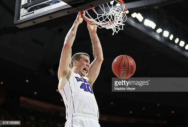 Marshall Plumlee of the Duke Blue Devils dunks the ball in the second half against the North CarolinaWilmington Seahawks during the first round of...