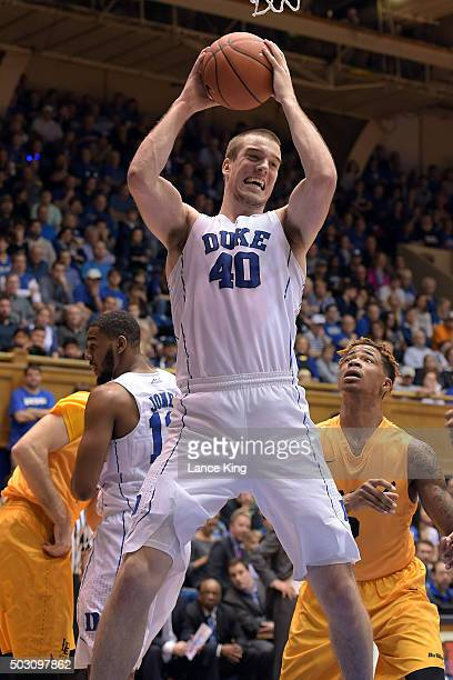 Marshall Plumlee of the Duke Blue Devils gets a defensive rebound against the Long Beach State 49ers at Cameron Indoor Stadium on December 30 2015 in...