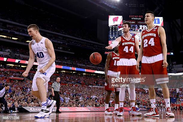 Marshall Plumlee of the Duke Blue Devils reacts after a play in the second half as Frank Kaminsky and Bronson Koenig of the Wisconsin Badgers look on...