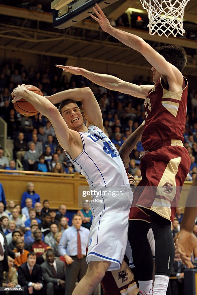 Marshall Plumlee #40 of the Duke Blue Devils rebounds against John Cain Carney #13 of the Boston College Eagles during their game at Cameron Indoor Stadium on January 3, 2015 in Durham, North Carolina.
