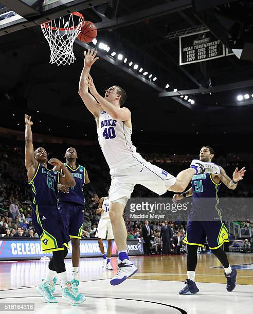 Marshall Plumlee of the Duke Blue Devils shoots the ball in the second half against the North CarolinaWilmington Seahawks during the first round of...