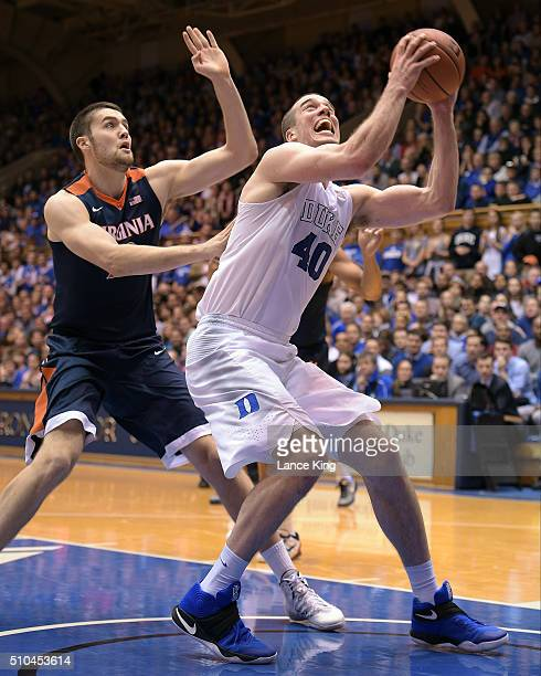 Marshall Plumlee of the Duke Blue Devils works on offense against Mike Tobey of the Virginia Cavaliers at Cameron Indoor Stadium on February 13, 2016...