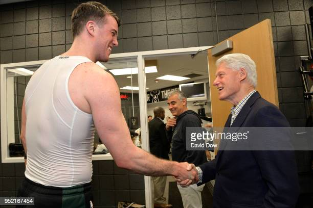 Marshall Plumlee of the Milwaukee Bucks exchanges a handshakes with former President of the United States of America Bill Clinton prior to Game Six...