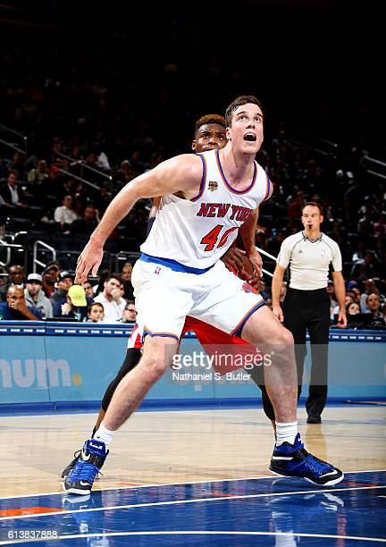 Marshall Plumlee of the New York Knicks boxes out Danuel House of the Washington Wizards during a preseason game on October 10 2016 at Madison Square...