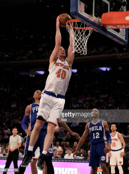 Marshall Plumlee of the New York Knicks dunks as Gerald Henderson of the Philadelphia 76ers defends at Madison Square Garden on April 12 2017 in New...