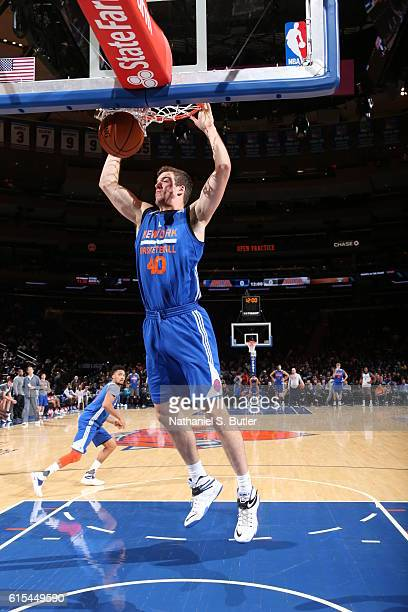 Marshall Plumlee of the New York Knicks dunks the ball during the Knicks Open Practice at Madison Square Garden on October 16 2016 in New York New...