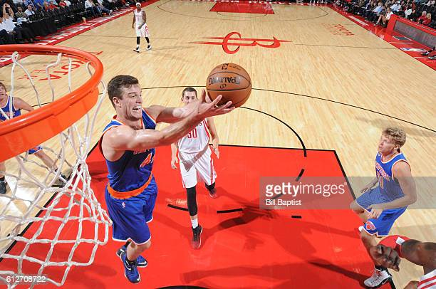 Marshall Plumlee of the New York Knicks grabs the rebound against the Houston Rockets during a preseason game on October 4 2016 at the Toyota Center...