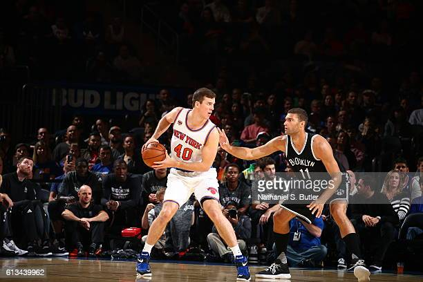 Marshall Plumlee of the New York Knicks handles the ball against the Brooklyn Nets at Madison Square Garden in New York City on OCTOBER 8 2016 NOTE...