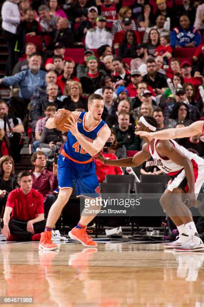 Marshall Plumlee of the New York Knicks handles the ball against the Portland Trail Blazers on March 23 2017 at the Moda Center in Portland Oregon...
