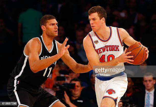 Marshall Plumlee of the New York Knicks in action against Brook Lopez of the Brooklyn Nets at Madison Square Garden on October 8 2016 in New York...