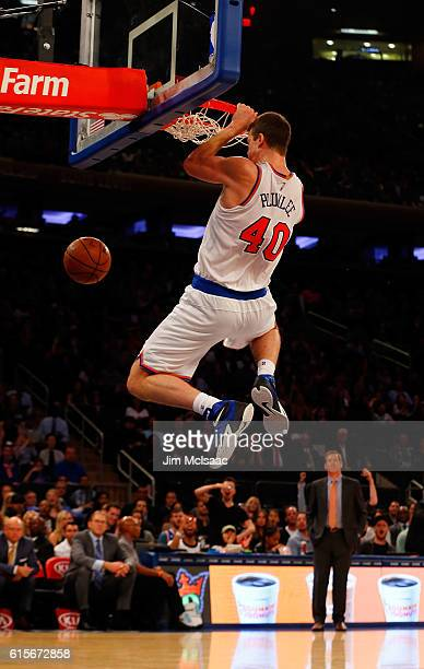Marshall Plumlee of the New York Knicks in action against the Brooklyn Nets at Madison Square Garden on October 8 2016 in New York City The Knicks...