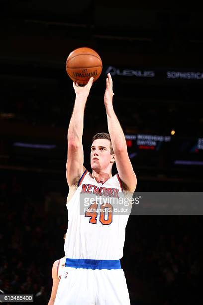 Marshall Plumlee of the New York Knicks shoots a free throw against the Brooklyn Nets at Madison Square Garden in New York City on October 8 2016...