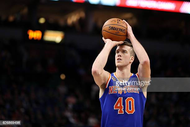 Marshall Plumlee of the New York Knicks shoots a free throw during the game against the Minnesota Timberwolves on November 30 2016 at Target Center...