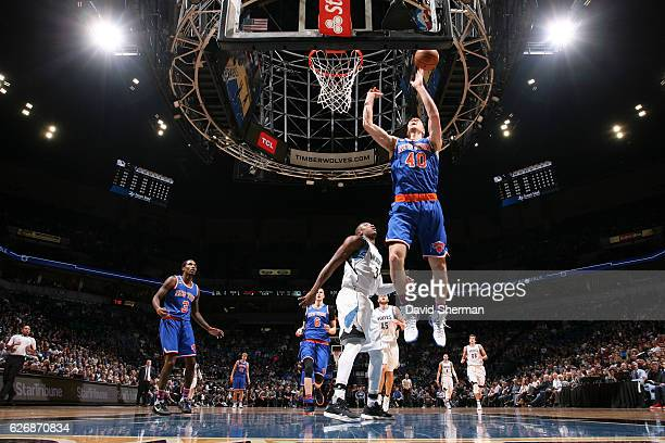Marshall Plumlee of the New York Knicks shoots a lay up during the game against the Minnesota Timberwolves on November 30 2016 at Target Center in...