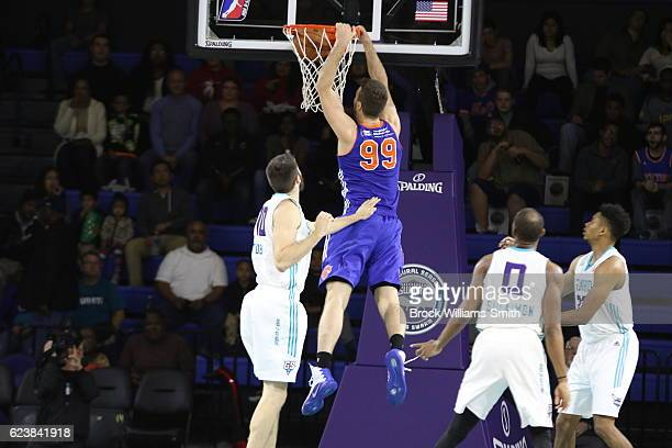 Marshall Plumlee of the Westchester Knicks dunks the ball against the Greensboro Swarm during the game at the The Field House at the Greensboro...