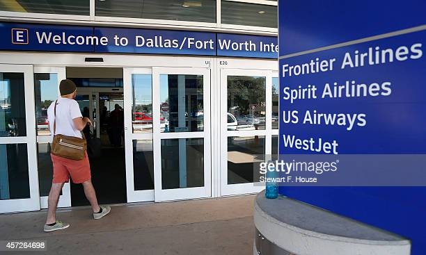 Marshall Samples of Richardson, Texas, enters Terminal E at Dallas/Fort Worth International Airport where Frontier Airlines has gates October 15,...