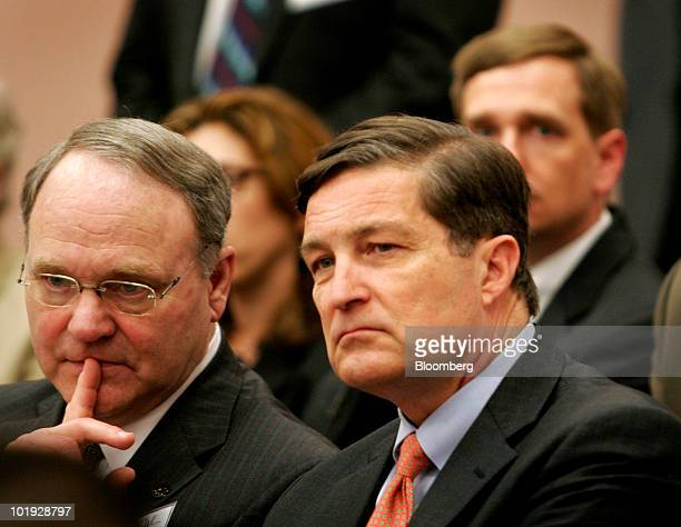 Marshall Smith president of John Tyler Community College left and Jeffrey Lacker president of the Federal Reserve Bank of Richmond listen to US...