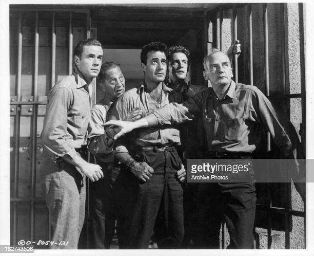 Marshall Thompson Jay Adler Gilbert Roland Alf Kjellin and Millard Mitchell escape jail in a scene from the film 'My Six Convicts' 1952