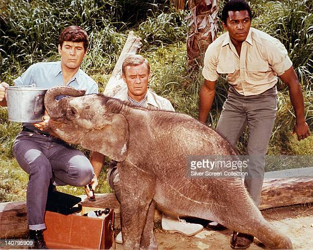 Marshall Thompson , US actor, Yale Summers, US actor, and Hari Rhodes , US actor, with a young elephant in a publicity still issued for the US...