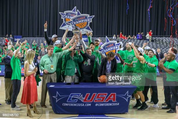 Marshall Thundering Herd celebrate after winning the Conference USA Basketball Championship game between the Western Kentucky Hilltoppers and...