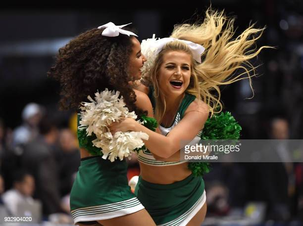 Marshall Thundering Herd cheerleaders celebrate after defeating the Wichita State Shockers during the first round of the 2018 NCAA Men's Basketball...