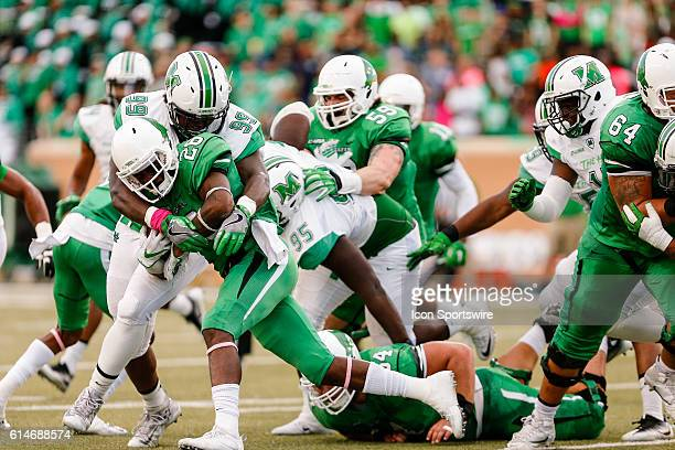 Marshall Thundering Herd defensive lineman Jason Smith tackles North Texas Mean Green running back Jeffrey Wilson during the game between the North...