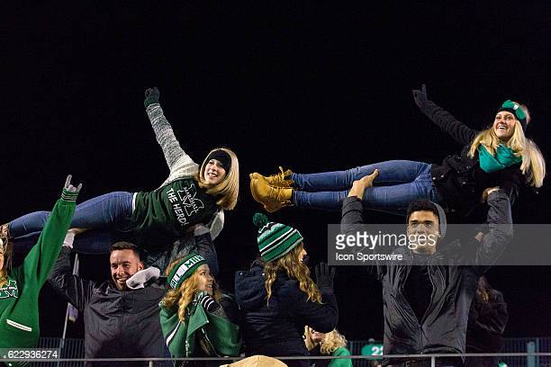 Marshall Thundering Herd fans celebrate a Marshall touchdown by lifting girls during the NCAA Football game between the Middle Tennessee Blue Raiders...