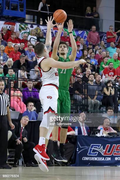 Marshall Thundering Herd forward Ajdin Penava shoots over Western Kentucky Hilltoppers forward Justin Johnson during the Conference USA Basketball...