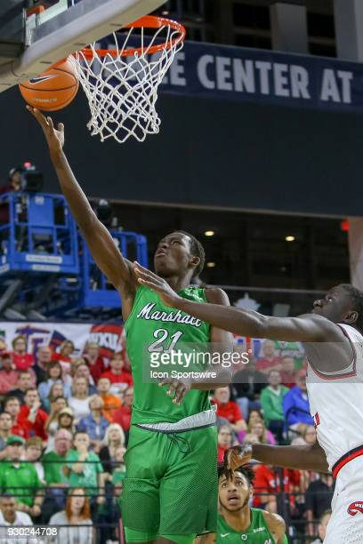 Marshall Thundering Herd forward Darius George lays the ball in during the Conference USA Basketball Championship game between the Western Kentucky...