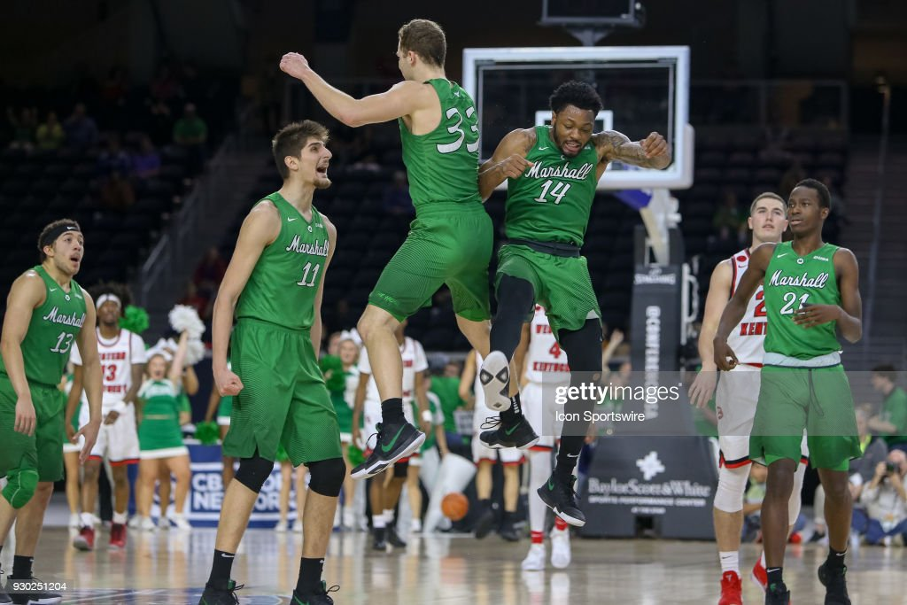Marshall Thundering Herd guard C.J. Burks (14) and guard Jon Elmore (33) celebrate during the Conference USA Basketball Championship game between the Western Kentucky Hilltoppers and Marshall Thundering Herd on March 10, 2018 at Ford Center at the Star in Frisco, TX.