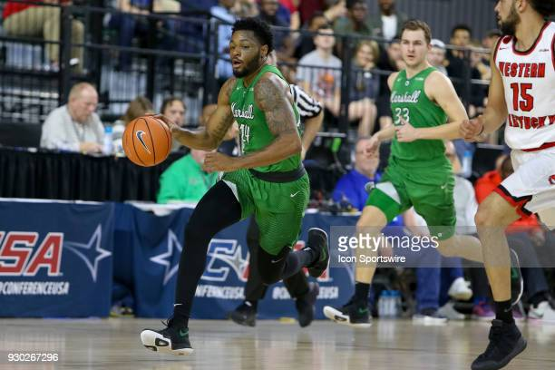 Marshall Thundering Herd guard CJ Burks brings the ball up the court on a fast break during the Conference USA Basketball Championship game between...
