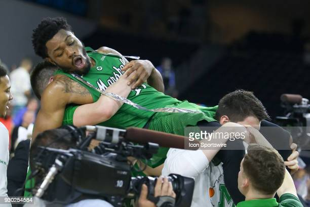 Marshall Thundering Herd guard CJ Burks is carried by his teammates after winning the Conference USA Basketball Championship game between the Western...
