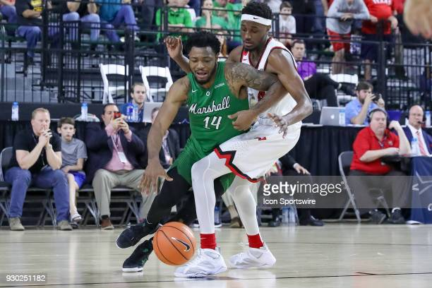 Marshall Thundering Herd guard CJ Burks is fouled by Western Kentucky Hilltoppers guard Josh Anderson during the Conference USA Basketball...