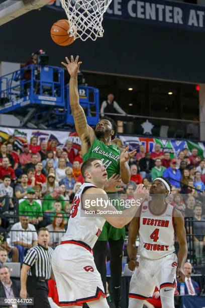 Marshall Thundering Herd guard CJ Burks shoots during the Conference USA Basketball Championship game between the Western Kentucky Hilltoppers and...