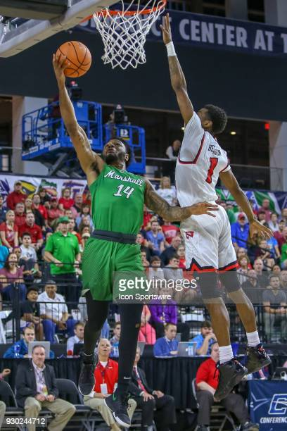 Marshall Thundering Herd guard CJ Burks shoots with Western Kentucky Hilltoppers guard Lamonte Bearden defending during the Conference USA Basketball...