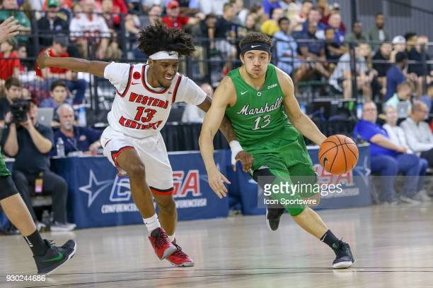 Marshall Thundering Herd guard Jarrod West drives around Western Kentucky Hilltoppers guard Taveion Hollingsworth during the Conference USA...