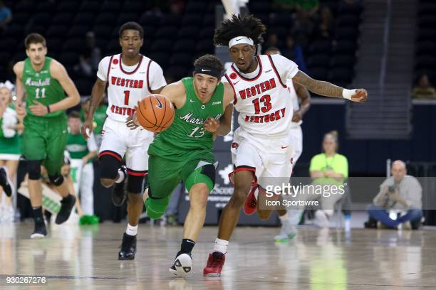 Marshall Thundering Herd guard Jarrod West is pursued by Western Kentucky Hilltoppers guard Taveion Hollingsworth during the Conference USA...