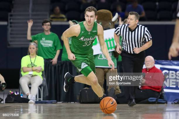 Marshall Thundering Herd guard Jon Elmore brings the ball up the court during the Conference USA Basketball Championship game between the Western...