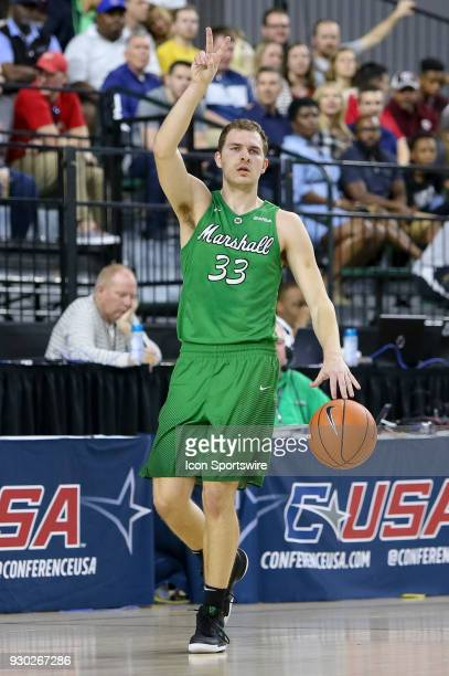 Marshall Thundering Herd guard Jon Elmore calls a play as he comes up the court during the Conference USA Basketball Championship game between the...