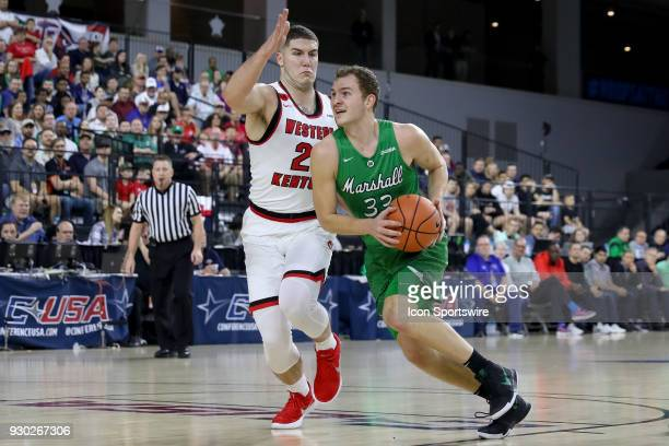 Marshall Thundering Herd guard Jon Elmore drives around Western Kentucky Hilltoppers forward Justin Johnson during the Conference USA Basketball...