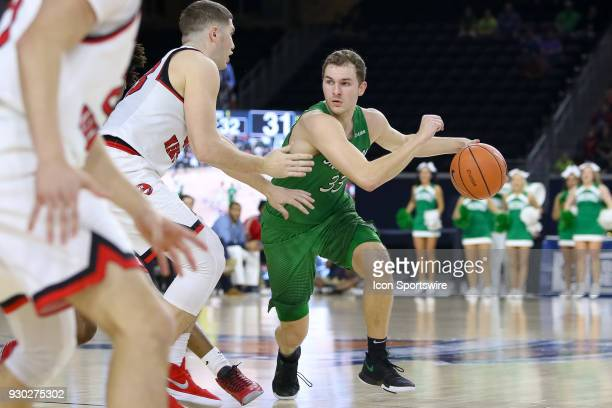 Marshall Thundering Herd guard Jon Elmore handles the ball during the Conference USA Basketball Championship game between the Western Kentucky...