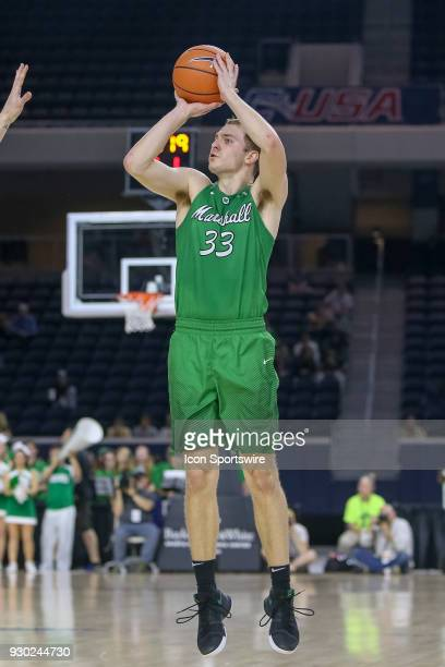 Marshall Thundering Herd guard Jon Elmore steps back for a three point shot during the Conference USA Basketball Championship game between the...
