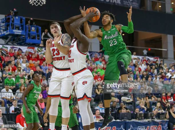 Marshall Thundering Herd guard Rondale Watson battles Western Kentucky Hilltoppers forward Moustapha Diagne and forward Justin Johnson for a rebound...